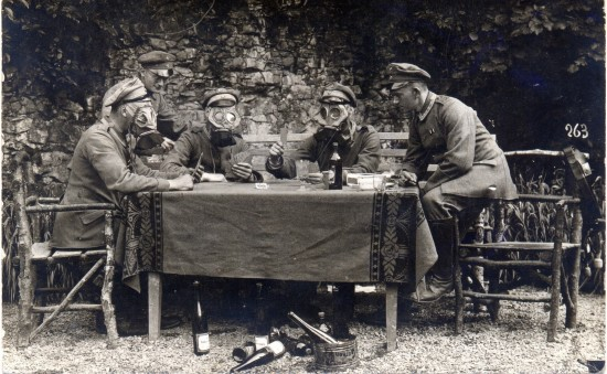 NCOs from Infanterie-Regiment Nr. 358 drink wine, feast on gherkins and play cards whilst wearing gas masks late in the Great War FLICKR drakegoodman