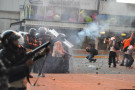 Tear_gas_used_against_protest_in_Altamira,_Caracas;_and_distressed_students_in_front_of_police_line